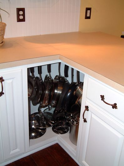 Hooks inside cabinets to hang pans, why didn't I think of THAT???: Pots Racks, Good Ideas, Lazy Susan, Inside Cabinets, Hooks, Corner Cupboard, Corner Cabinets, Hanging Pan, Hanging Pots