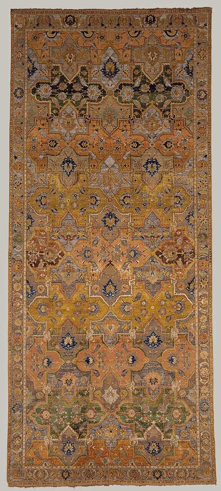 The type of design on this carpet has its roots in earlier #Iranian #carpets, but the rich silk pile, highlighted with gold and silver brocading, and muted but lively colors, signaled a change from the past.
