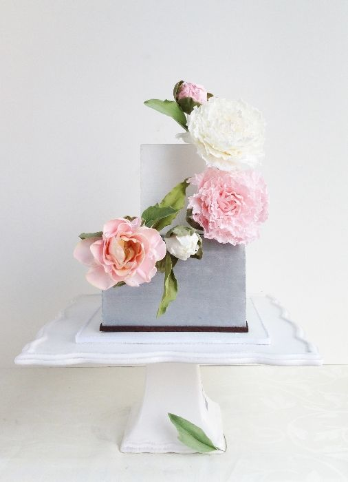 Square grey and white cake with blush pink and white flowers