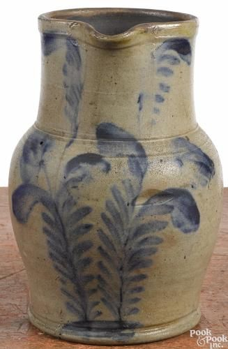Pennsylvania stoneware pitcher, 19th c., attributed to Remmey, with cobalt tulip decoration - Price Estimate: $300 - $500