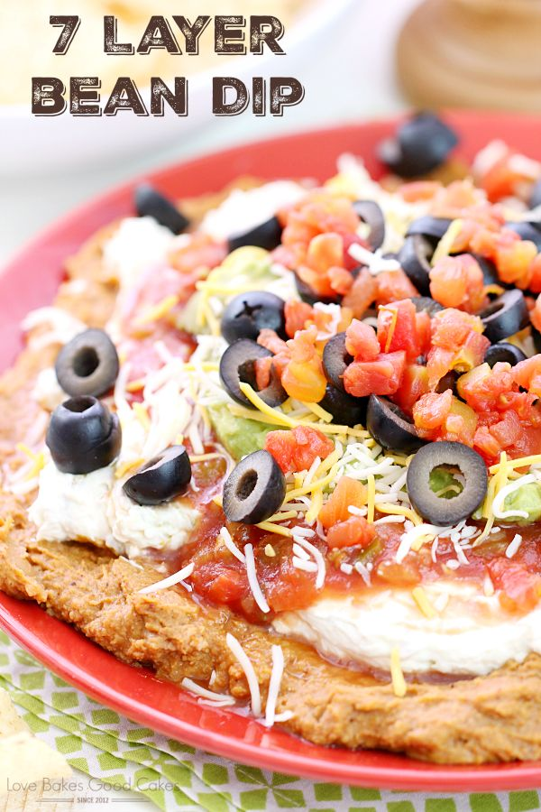 The classic 7 Layer Bean Dip - just like you remember it! It's great for fiestas, potlucks, game day entertaining - or anytime you need a delicious and easy idea that is a real crowd-pleaser!
