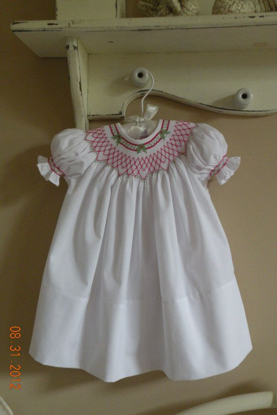 Hand Smocked Christmas Dress                        Sizes Newborn- 24 months $65