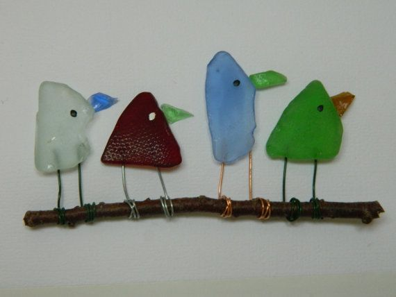 Four colorful sea glass birds created from the hard to find colors of blue, red, aqua and green. All sea glass and driftwood were collected