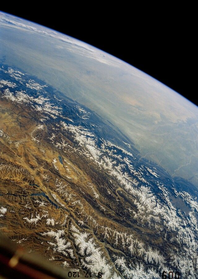 Earth & The Himalayas - Looking south across the Tibetan Plateau over the Himalayas and into the Indian Subcontinent.