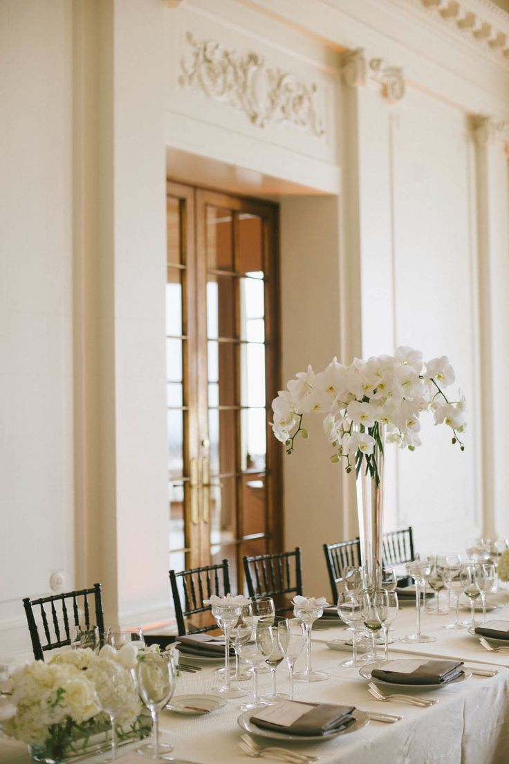 White wedding flowers at the Flood Mansion in San Francisco...tall, modern centerpieces with cascading orchids; low, lush arrangements throughout.