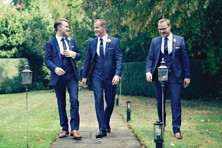 Mr Williamson in his made to measure navy wedding suit and his groomsmen in the hire version of this slim fit suit. #wedding #suits #groom #slimfit #madetomeasure #anthonyformalwear