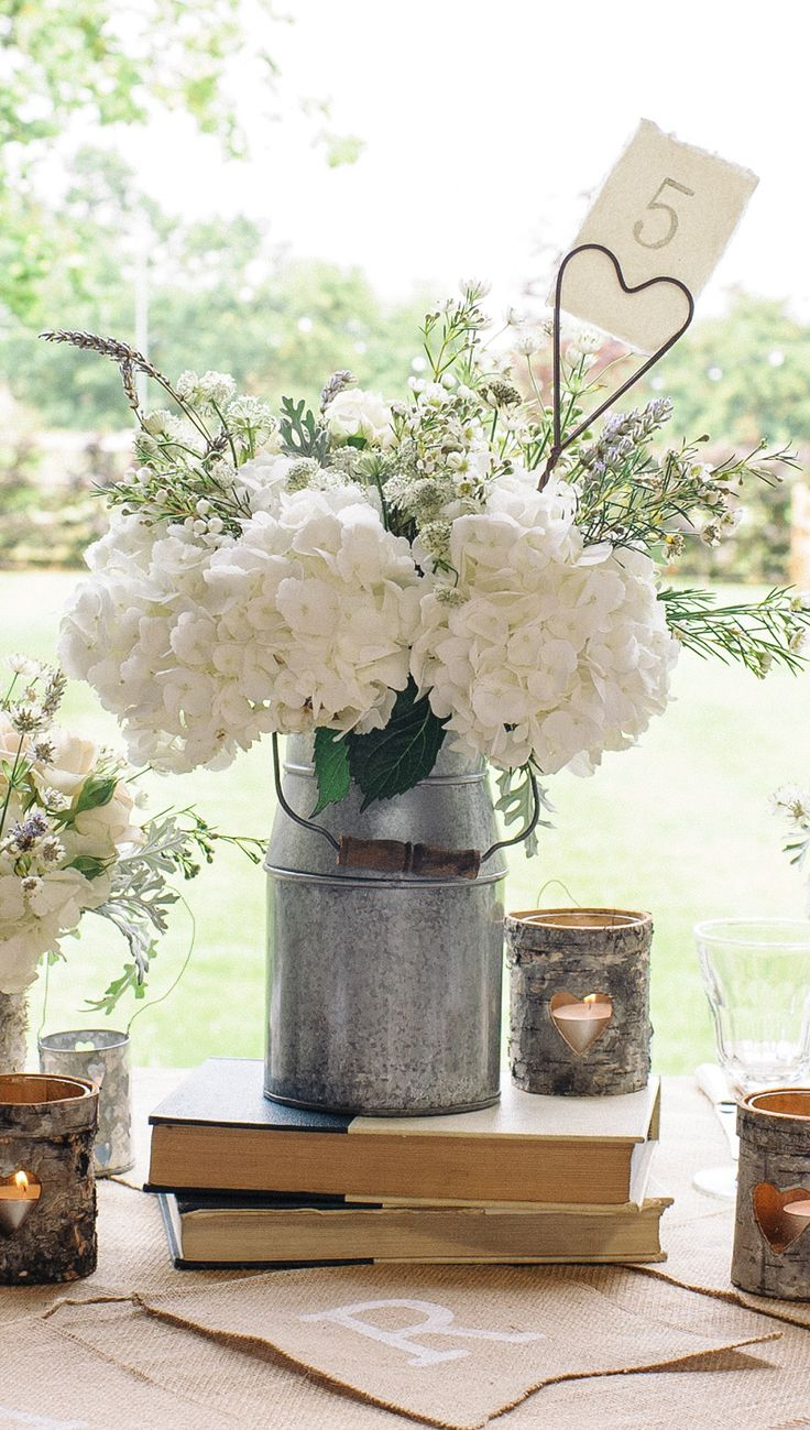milk churn vase wedding centrepieces