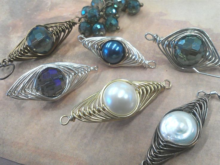 Wire wrapping. I took a class with this                                 wrapping technique from  Debbie Rhodes. Looking forward to working with you again Deb.