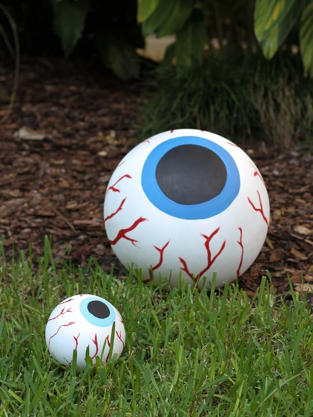 How to Make Giant Bloodshot-Eye Halloween Decor: For this creepy craft, you will need one large exercise ball, one beach ball or bouncy ball, acrylic paint in various colors, a paintbrush, a medium-sized bowl, white spray paint, medium and extra-fine-grit sandpaper and spray sealant. From DIYnetwork.com