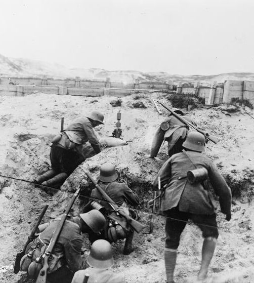 WWI, July 1917; A German minenwerfer (trench mortar) section in action in the dunes on the Flanders Coast. ©IWM Q 50665