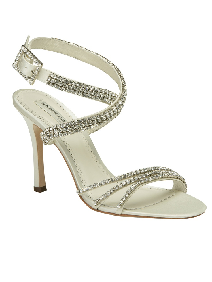 Your bridal pedicure will stay beautiful in the glamorous Astor bridal sandal is hand crafted by Paradox London using the finest duchesse silk. This stunning Swarovski crystal wedding shoe features soft kid leather lining and the highest quality leather soles.The 3 1/2 inch bridal heel is the perfect height to pick up the hem of your chiffon bridal gown and keep you comfortable.  $299