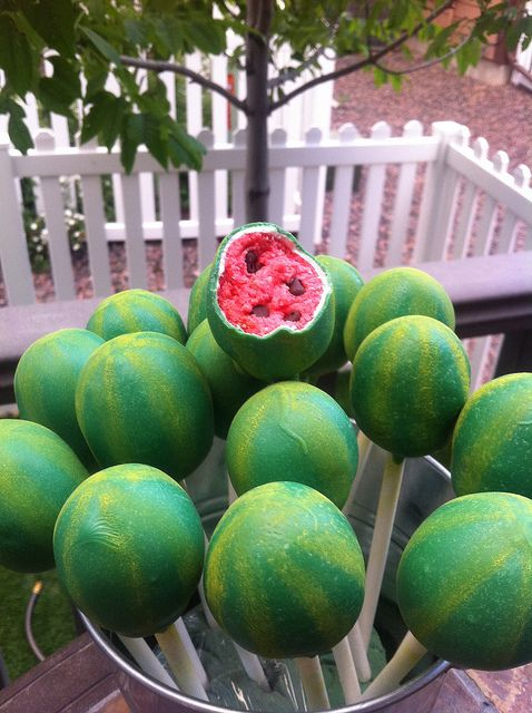 watermelon cake pops... There isn't a tutorial, but I am thinking pink cake with chocolate chips dipped in green candy melts, and maybe a yellow edible marker? @Jessica Tilley and @Danielle Stennett = I think you guys would love this!