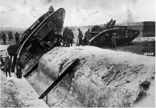 Germans testing the climbing powers of captured British tanks, redecorated in German colours, circa 1917