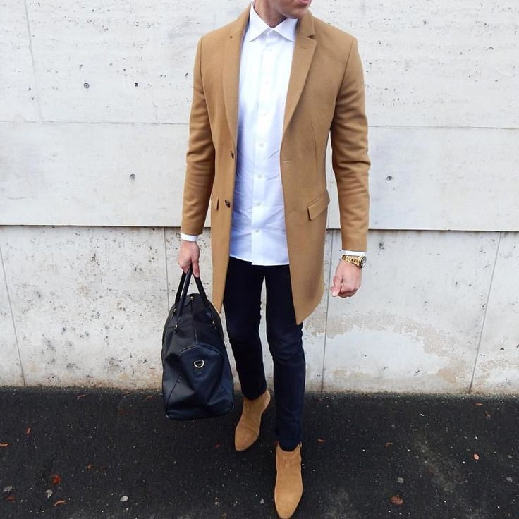 Light brown coat and white shirt underneath with black jeans and also black bag