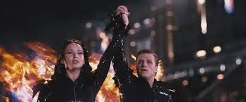 Image result for katniss and peeta gladiator outfit
