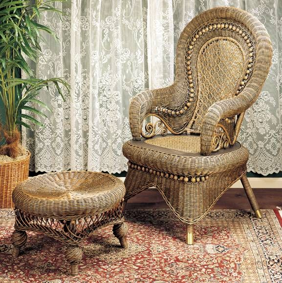 Country Wicker Arm Chair Regal with its high rounded back, this country arm chair is a faithful reproduction of popular styling from an earlier century. Wicker makes a grand showing across ram's horn curvature at the arm fronts ending in elegant cane curlicues. Honeycomb mesh adds its lacy see-through effects while beading provides dimensional accenting at the back and across the front apron.