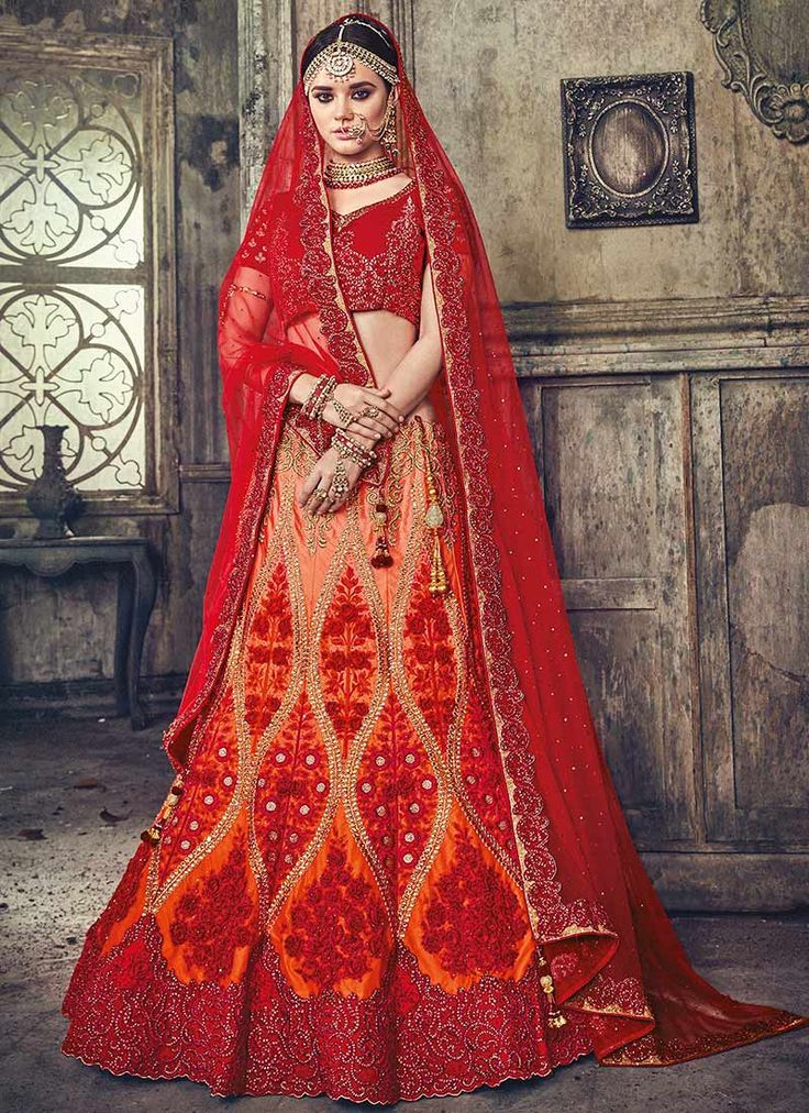 Buy Peach N Red Velvet A Line Lehenga online, SKU Code: GHMKNS14003. This Red  color Wedding a line lehenga for Women comes with Embroidered Velvet. Shop Now!