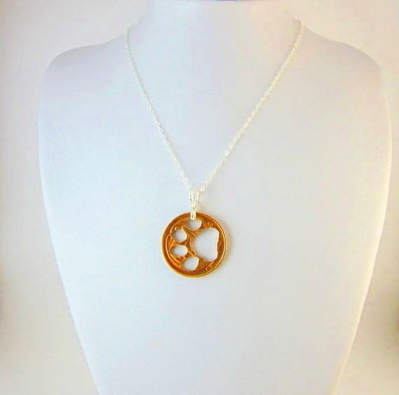 Hey, I found this really awesome Etsy listing at https://www.etsy.com/listing/545268707/paw-pendant-necklace-coin-cut-out-unique