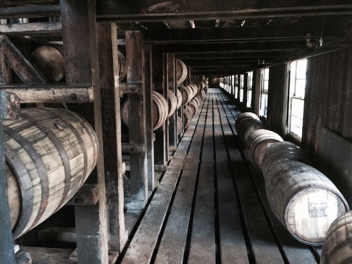 Kentucky Bourbon- there are at least three distilleries that I've found that use 100% non-GMO corn in their various whiskeys: Wild Turkey, Four Roses, and Buffalo Trace.