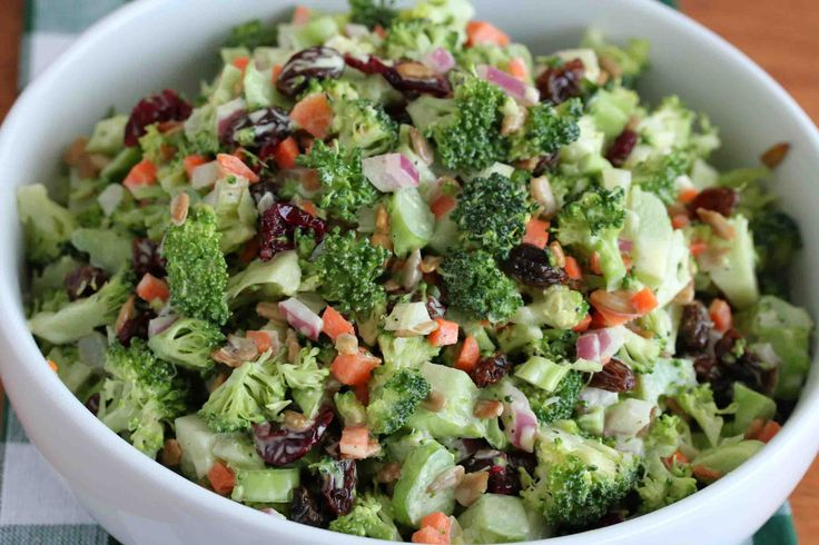 This Creamy Broccoli Salad combines several vegetables along with raisins, dried cranberries, sunflower seeds, and a delicious cider coleslaw dressing.