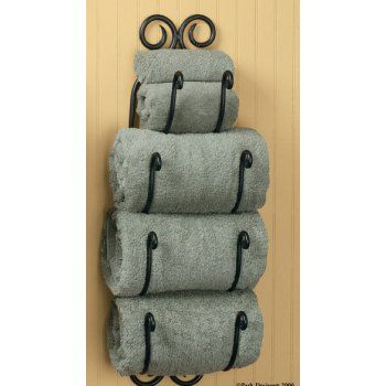 Iron Bathroom Towel Holder This towel organizer holds 4 towels. Made of iron with a scroll design at the top.  Wall mount.  27