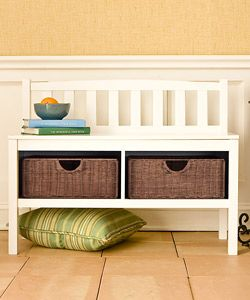 Add a contemporary touch to your home decor with this Beacon white bench  White storage bench includes two rattan baskets for storing all your necessities  Stylish furniture piece gives you a convenient seat and additional storage