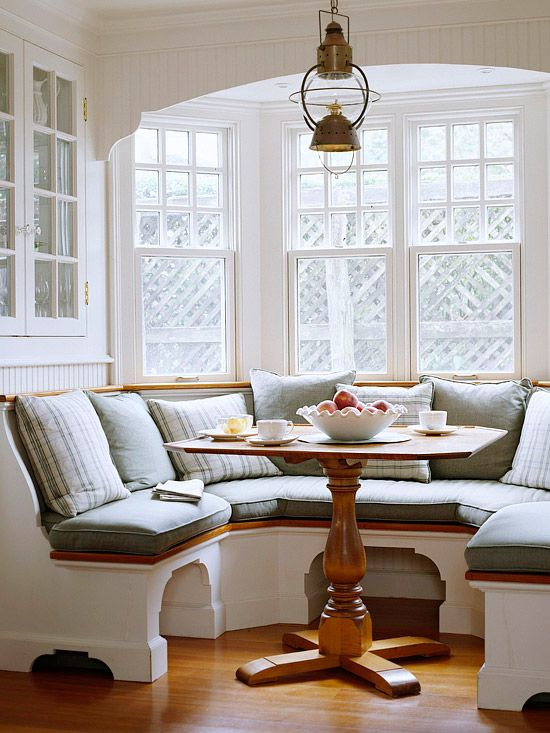 Another great space for a dream beach home.  Oil lantern light, bay window and around seating- really maximizes the space, and the stand for the table is beautiful. (I love the maple color as well)     I've always wanted a cozy breakfast space like this in a kitchen, it reminds me  of grandparent's .  Like the space beneath the seating to tuck your legs