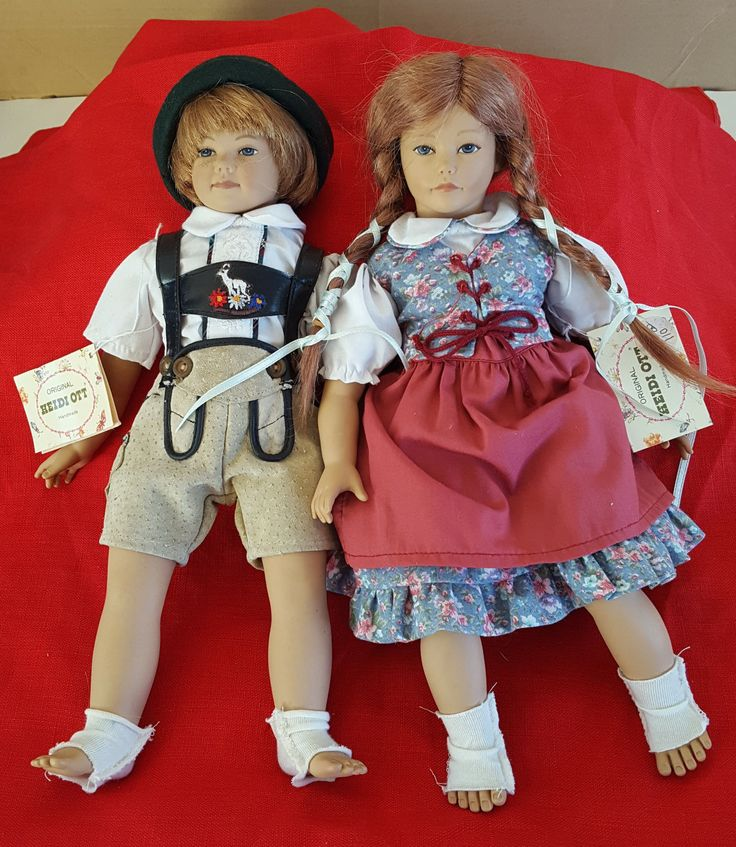 """The boy """"Seppi"""" is 12"""" and is dressed in a white embroidered shirt with German """"Laderhosen"""". His body is cloth and he has vinyl arm, legs, and head. Very Cute! The girl """"Susi"""" is dressed in a skirt and vest and her hair is braided into pig tails. 