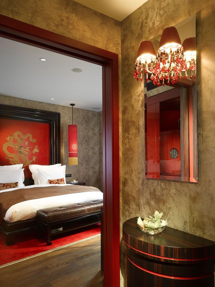 Buddha Bar Hotel Prague, Czech Republic. #lamp #wallsconces #warm #color #interior #lighting #design #oriental #style #hotel #bed #room