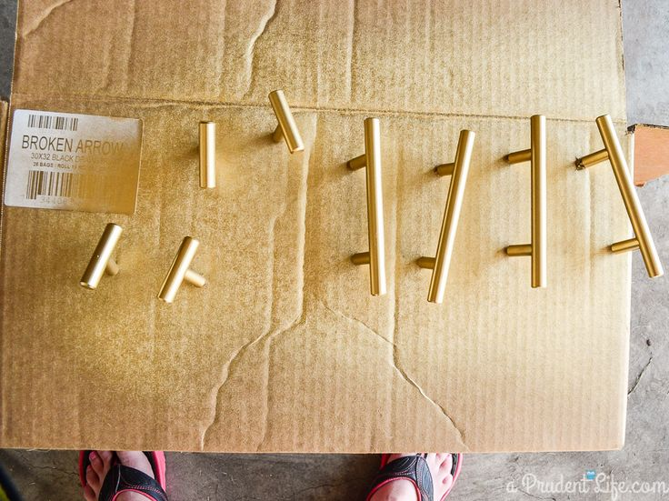 to spray cabinet handles, push screws through cardboard and secure hardware as if installed on cabinet, spray :) {Updating Inexpensive Cabinet Hardware|