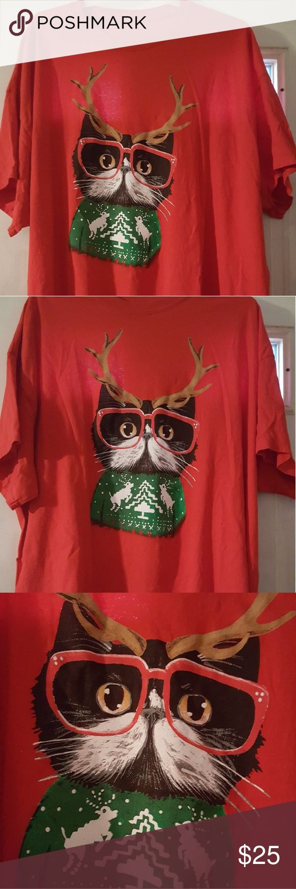 Ugly Christmas cat t-shirt ladies 3x Red Ladies 3x Ugly Christmas T-shirt in red with cure cat wearing red glasses and reindeer horns and his own ugly christmas sweater!  Size is ladies 3x measures 26 inches shoulder to shoulder  Measures 30 inches from shoulder to hem Tops Tees - Short Sleeve