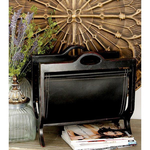 Updated traditional Magazine Rack in burnished rich deep espresso featuring matching leather sling with intricate stitching and accent embellishments.