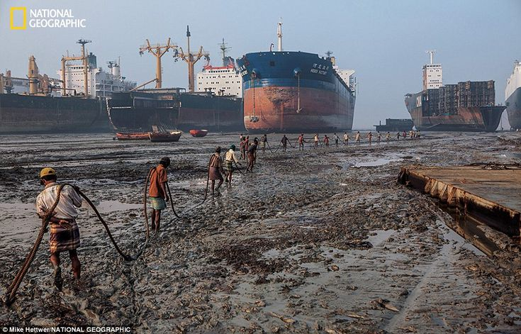 Arduous: At low tide ship-breakers haul a 10,000-pound cable to a beached ship to winch pi... http://dailym.ai/1muZtk9#i-9bb60e3d