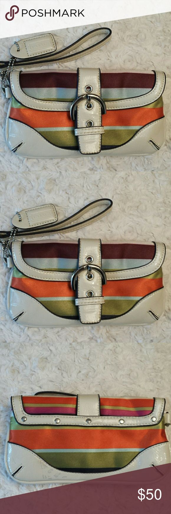 Coach Legacy Satin Stripe Wristlet Coach Legacy Satin Orange, green, and blue Stripe Wristlet, Buckle Snap closure, Zippered Closure inside and mirror and Zippered pocket inside, Patent has some wear spots see pics otherwise good condition Coach Bags Clutches & Wristlets