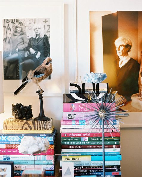Decor Photo - Stacks of books with framed photography and decorative objects