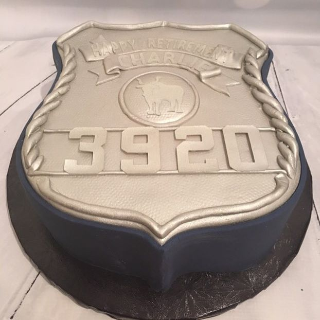 Police Retirement Cake for one of Erik's guys. I wish I had better pictures. We made 2 shields, one for each retiree. The top of each shield says Happy Retirement instead of Suffolk County, and their names instead of Police. #police #fortheloveoffrosting #instacake #policecake #policeshield #scpd #thinblueline #thanksforyourservice #policeretirement #policecakes
