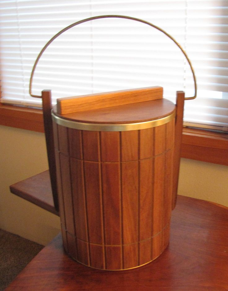 midcentury modern design walnut ice bucket made by american maker ransburg of indianapolis, indiana. classic danish modern look.