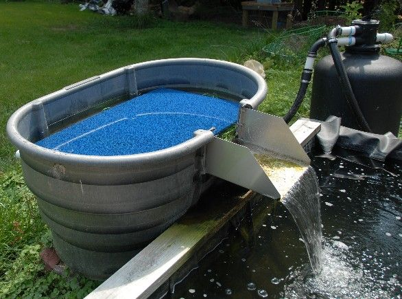 100 best images about pond bog filter ideas and designs on for Homemade koi pond filter