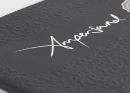 ampersand, meaning character or symbol. and embossing meaning to carve, mould, or stamp a design on a surface/object.