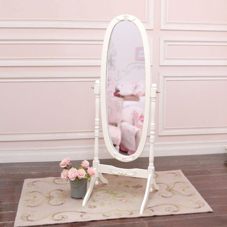 "This gorgeous oval mirror would be perfect as part of your bedroom or home decor! The mirror rotates on its stand making it the perfect dressing mirror. The frame features lovely roses. Great for any cottage style home!   Has been painted our popular soft white color! Edges have been distressed to emulate a vintage appearance. Also features our popular rose appliques!   • 59""H x 22""W x 11""D • White"