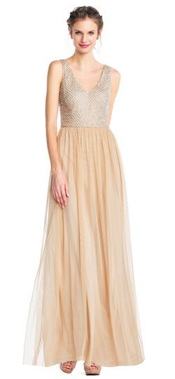 dd56cfb3c0a8 Adrianna Papell   Sleeveless Tulle Gown with Pearl Beaded Bodice   This  elegant gown features a sleeveless bodice with a v-neckline and v-back, ...