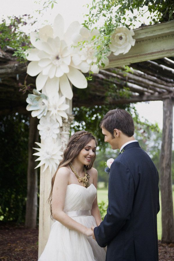 pretty paper flowers decorating the ceremony spot