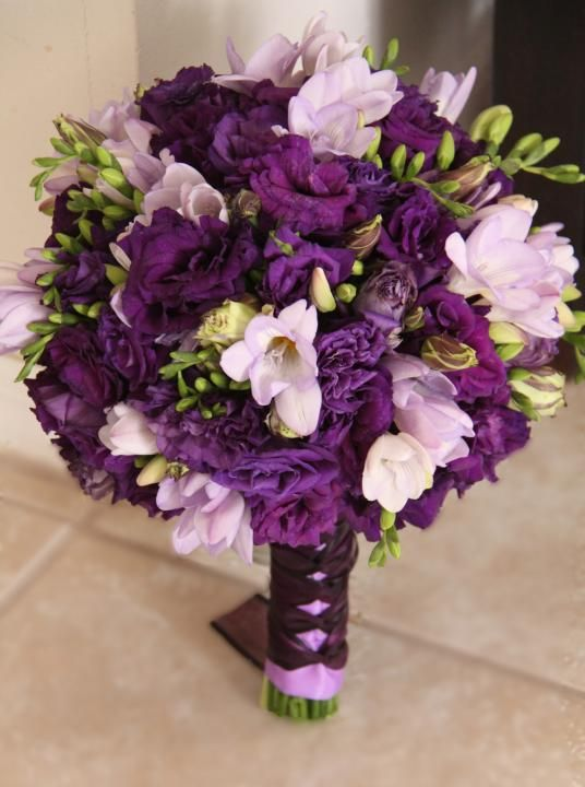purple and white wedding bouquets