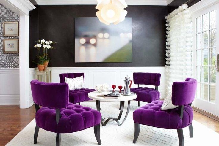 sitting room purple black, focused around the table for conversation.