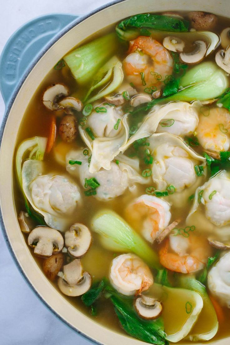 Easy Homemade Wonton Soup by jessicagavin: Each hearty bowl is packed with plump pork dumplings, fresh vegetables and jumbo shrimp. This authentic Asian meal is fun to make. #Soup  #Wonton