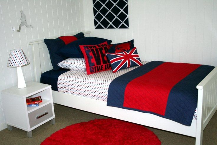 Block colour of red & navy in this coverlet works well with the Patersonrose spot quiltcover & shaggy regal red rug.