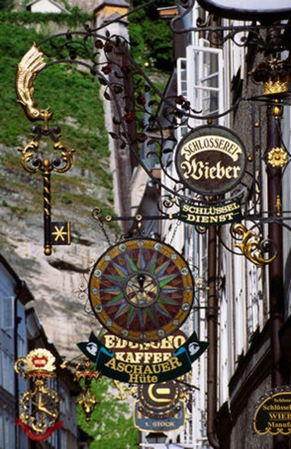shop signs in Salzburg- Why can't Americans have this sort of beauty on our streets too??