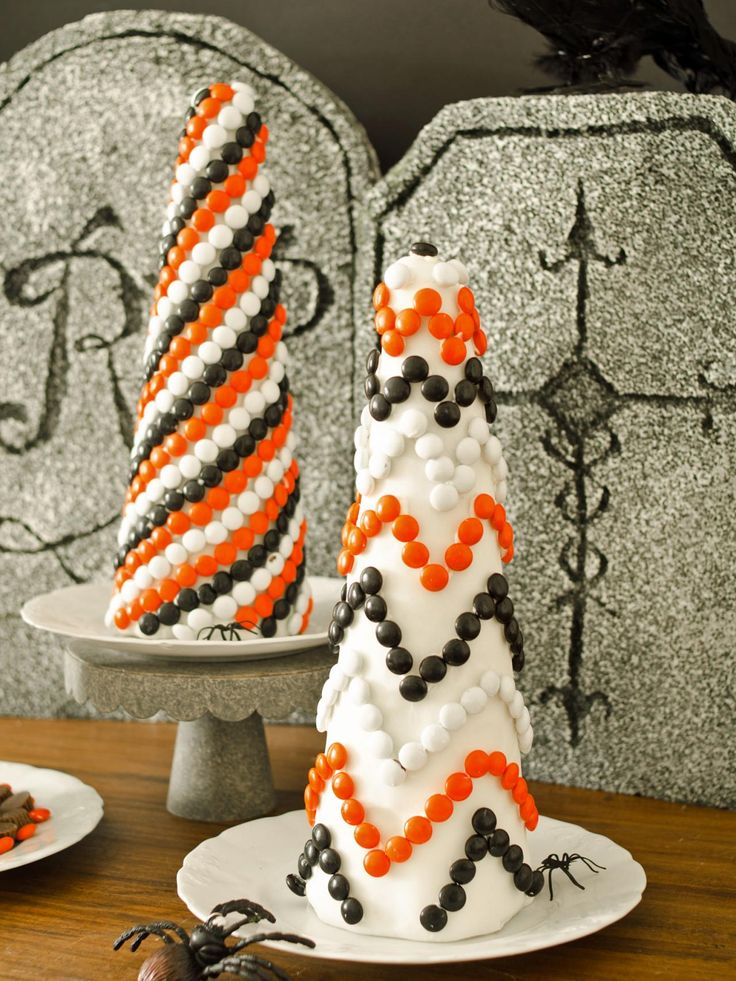 Cover inexpensive foam topiary forms with fondant and candy to create a sweet Halloween decoration or centerpiece that kids will love helping to craft. Learn how to make your own.