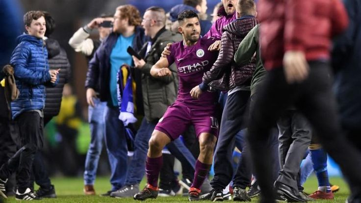 Sergio Aguero appears to clash with Wigan fan on pitch: TV footage appeared to show the City striker raising his arm to push a supporter…