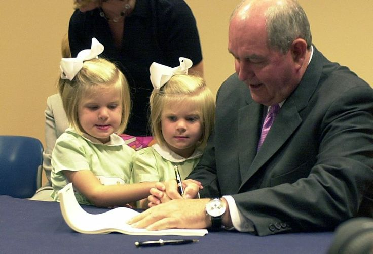 In May, we will celebrate the Tenth Anniversary of Bright from the Start! From our photo album, here's Governor Sonny Perdue in 2004 signing the bill creating the new agency...with his twin granddaughters looking on.